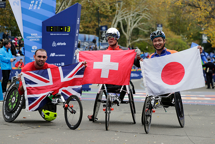 <div class='meta'><div class='origin-logo' data-origin='AP'></div><span class='caption-text' data-credit=''>The winners of the men's wheelchair division, left, second place finisher John Smith of England, first finisher Marcel Hug of Switzerland and third finisher Sho Watanabe of Japan.</span></div>