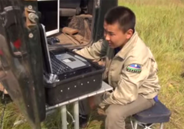 """<div class=""""meta image-caption""""><div class=""""origin-logo origin-image """"><span></span></div><span class=""""caption-text"""">A drone controller continues searching through the thick of it. (Photo/Ministry of Emergency Situations in Republic Sakha)</span></div>"""