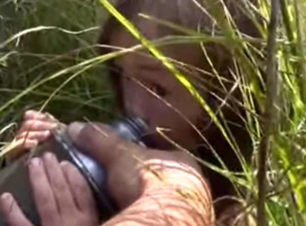 """<div class=""""meta image-caption""""><div class=""""origin-logo origin-image """"><span></span></div><span class=""""caption-text"""">Karina is discovered by rescuers, in a bed of long grass. Dehydrated and emaciated, they immediately gave her crackers and water. (Photo/Ministry of Emergency Situations in Republic Sakha)</span></div>"""