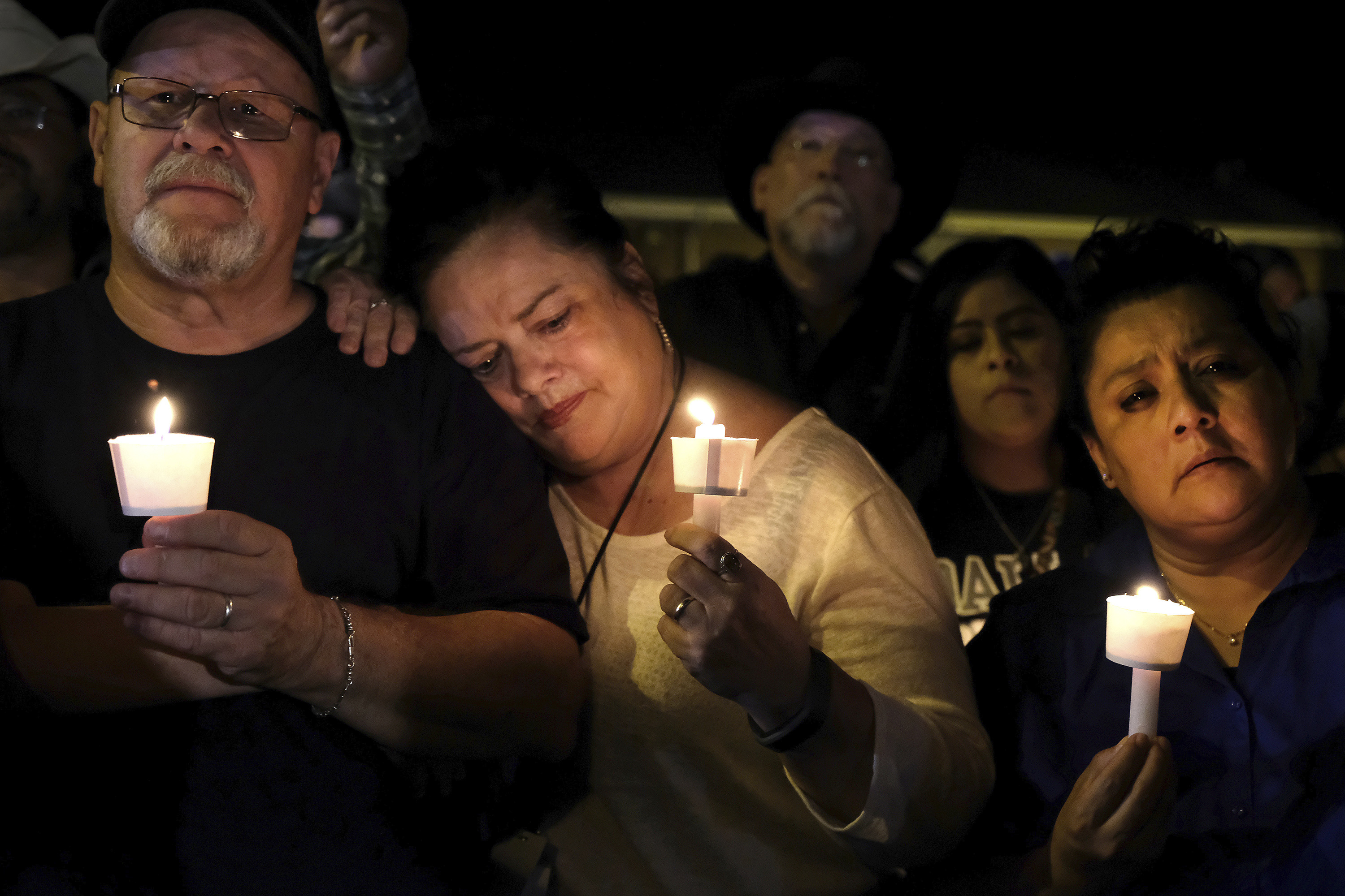 "<div class=""meta image-caption""><div class=""origin-logo origin-image none""><span>none</span></div><span class=""caption-text"">Community members come together for a candlelight vigil for the victims of a deadly church shooting in Sutherland Springs, Texas, Sunday, Nov. 5, 2017. (Laura Skelding/AP Photo)</span></div>"