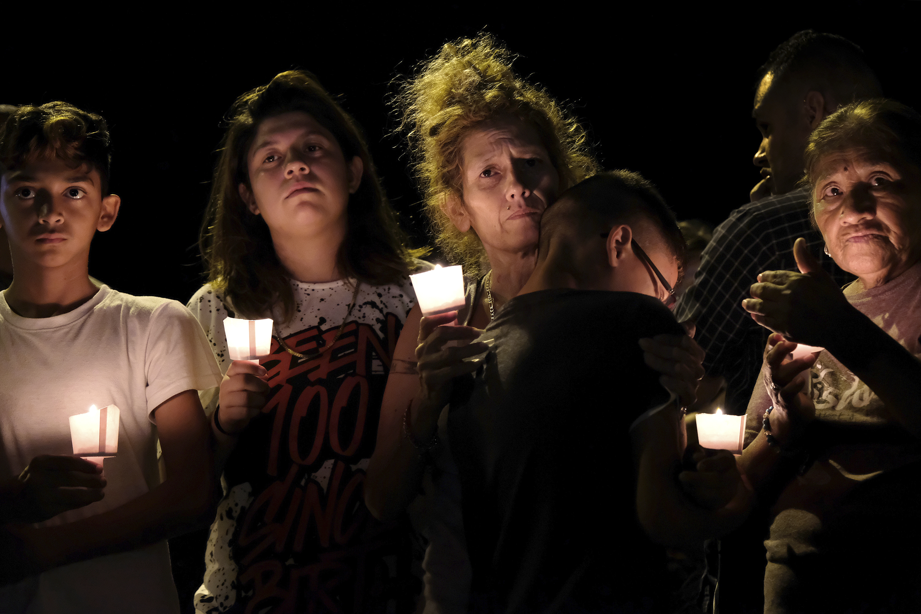 "<div class=""meta image-caption""><div class=""origin-logo origin-image none""><span>none</span></div><span class=""caption-text"">From left are Christopher Rodriguez, Esmeralda Rodriguez, Mona Rodriguez, Jayanthony Hernandez, 12, and Juanita Rodriguez participate in a candlelight vigil for the victims. (Laura Skelding/AP Photo)</span></div>"