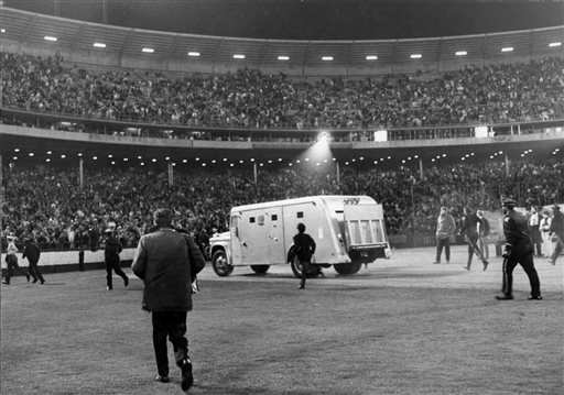 "<div class=""meta image-caption""><div class=""origin-logo origin-image ""><span></span></div><span class=""caption-text"">In this photo taken Aug. 29, 1966, the Beatles are driven away in an armored car after performing at Candlestick Park in San Francisco. (Fred Pardini)</span></div>"