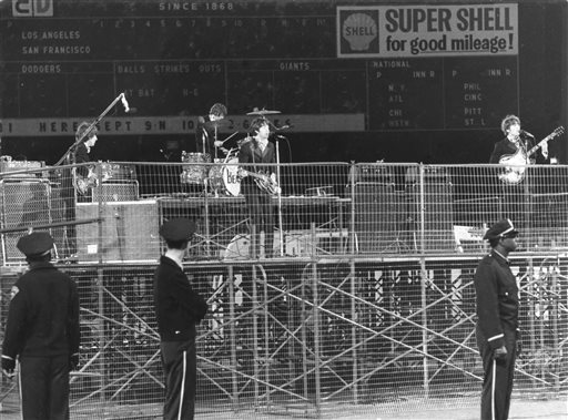 "<div class=""meta image-caption""><div class=""origin-logo origin-image ""><span></span></div><span class=""caption-text"">In this photo taken Aug. 29, 1966, spectators watch the Beatles perform at Candlestick Park in San Francisco. (Fred Pardini)</span></div>"