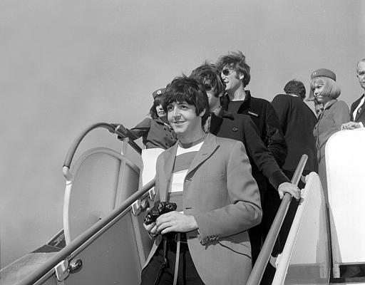 "<div class=""meta image-caption""><div class=""origin-logo origin-image ""><span></span></div><span class=""caption-text"">Paul McCartney, followed by Ringo Starr and John Lennon of the Beatles, arrive by plane at San Francisco International Airport on Aug. 29, 1966.</span></div>"
