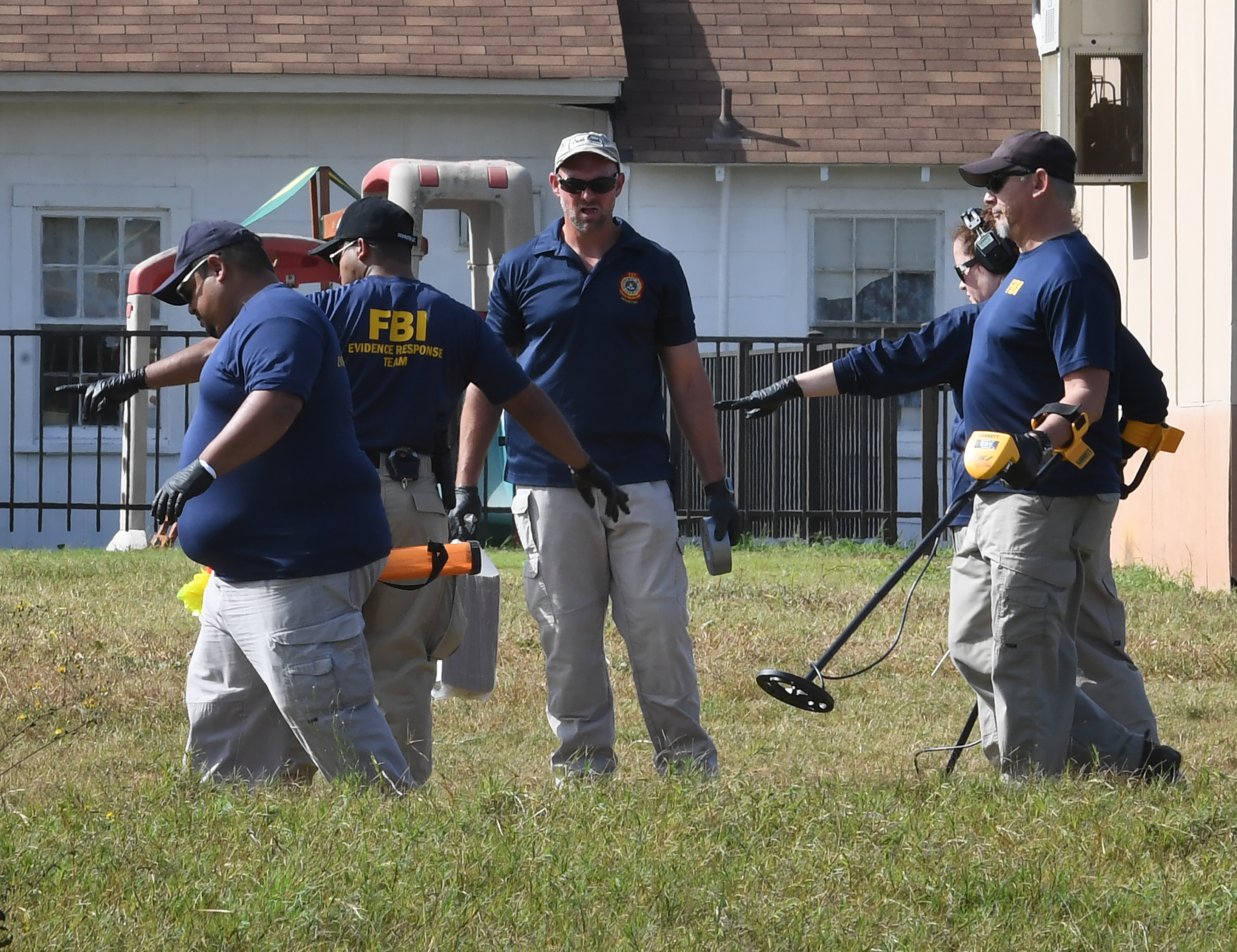 "<div class=""meta image-caption""><div class=""origin-logo origin-image none""><span>none</span></div><span class=""caption-text"">FBI agents search for clues at the entrance to the First Baptist Church, after a mass shooting that killed 26 people in Sutherland Springs, Texas on November 6, 2017. (MARK RALSTON/AFP/Getty Images)</span></div>"
