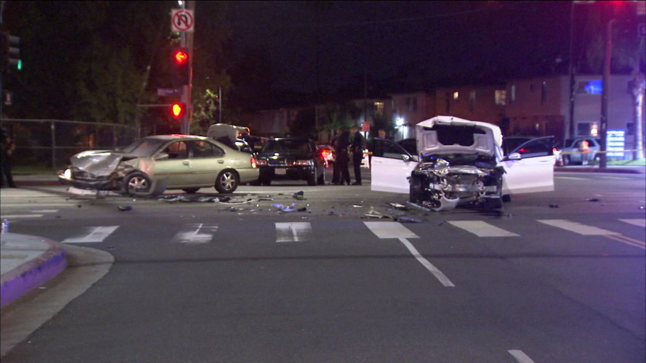 A suspect vehicle and a white Mercedes-Benz seen mangled after a crash that ended in North Hollywood on Monday, Nov. 6, 2017.