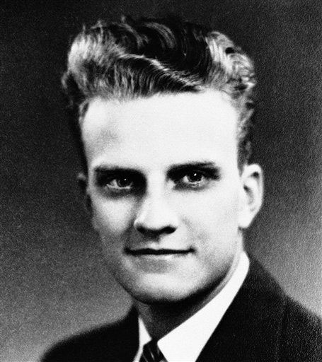"<div class=""meta image-caption""><div class=""origin-logo origin-image ap""><span>AP</span></div><span class=""caption-text"">William ""Billy"" Graham at age 17 on his graduation from Charlotte High School in June 1935.</span></div>"