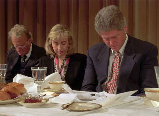 "<div class=""meta image-caption""><div class=""origin-logo origin-image ap""><span>AP</span></div><span class=""caption-text"">President and Mrs. Clinton, along with Rev. Billy Graham bow their heads during the annual National Prayer Breakfast in Washington Feb.4, 1993.</span></div>"