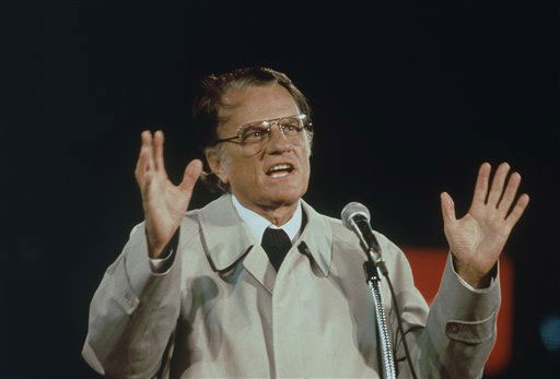 "<div class=""meta image-caption""><div class=""origin-logo origin-image ap""><span>AP</span></div><span class=""caption-text"">Billy Graham shown speaking in Tokyo in which he delivered the Christian message, in this predominantly Buddhist Nation, to a crowd of 43,000 at Korakuen Stadium on Oct. 1980.</span></div>"