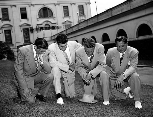 "<div class=""meta image-caption""><div class=""origin-logo origin-image ap""><span>AP</span></div><span class=""caption-text"">Billy Graham, second from right, kneels in prayer on the White House Lawn July 14,1950 with friends, asking divine aid for President Truman in his handling of the Korean crisis.</span></div>"
