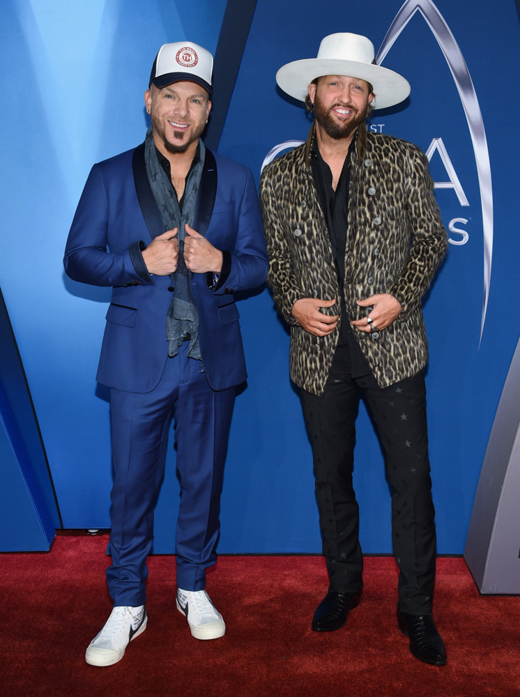 "<div class=""meta image-caption""><div class=""origin-logo origin-image none""><span>none</span></div><span class=""caption-text"">Chris Lucas, left, and Preston Brust, of LoCash, arrive at the 51st annual CMA Awards on Wednesday, Nov. 8, 2017, in Nashville, Tenn. (Evan Agostini/Invision/AP)</span></div>"