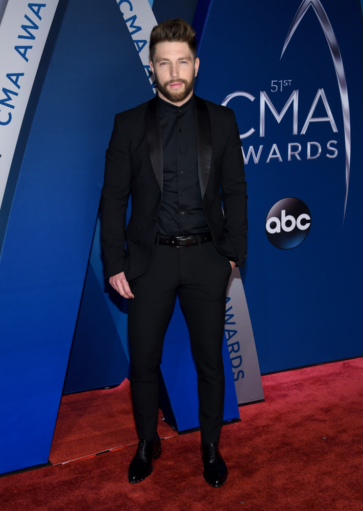 "<div class=""meta image-caption""><div class=""origin-logo origin-image none""><span>none</span></div><span class=""caption-text"">Chris Lane arrives at the 51st annual CMA Awards on Wednesday, Nov. 8, 2017, in Nashville, Tenn. (Evan Agostini/Invision/AP)</span></div>"