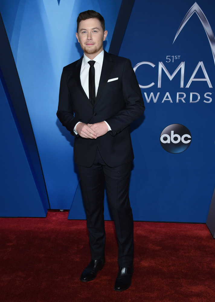 "<div class=""meta image-caption""><div class=""origin-logo origin-image none""><span>none</span></div><span class=""caption-text"">Scotty McCreery arrives at the 51st annual CMA Awards on Wednesday, Nov. 8, 2017, in Nashville, Tenn. (Evan Agostini/Invision/AP)</span></div>"