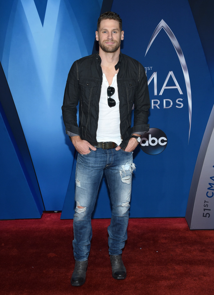 "<div class=""meta image-caption""><div class=""origin-logo origin-image none""><span>none</span></div><span class=""caption-text"">Chase Rice arrives at the 51st annual CMA Awards on Wednesday, Nov. 8, 2017, in Nashville, Tenn. (Evan Agostini/Invision/AP)</span></div>"