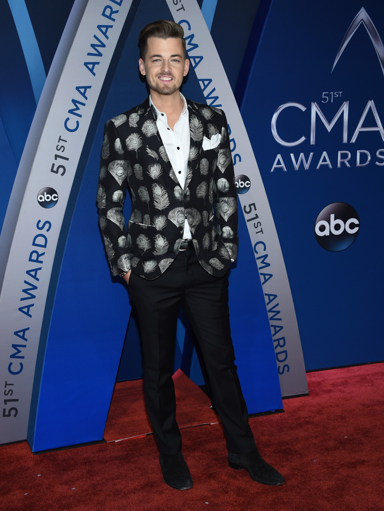 "<div class=""meta image-caption""><div class=""origin-logo origin-image none""><span>none</span></div><span class=""caption-text"">Chase Bryant arrives at the 51st annual CMA Awards on Wednesday, Nov. 8, 2017, in Nashville, Tenn. (Evan Agostini/Invision/AP)</span></div>"