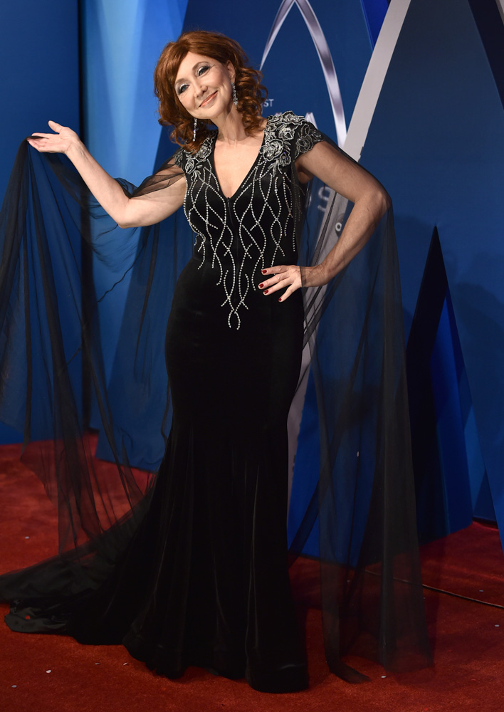 "<div class=""meta image-caption""><div class=""origin-logo origin-image none""><span>none</span></div><span class=""caption-text"">Pam Tillis arrives at the 51st annual CMA Awards on Wednesday, Nov. 8, 2017, in Nashville, Tenn. (Evan Agostini/Invision/AP)</span></div>"