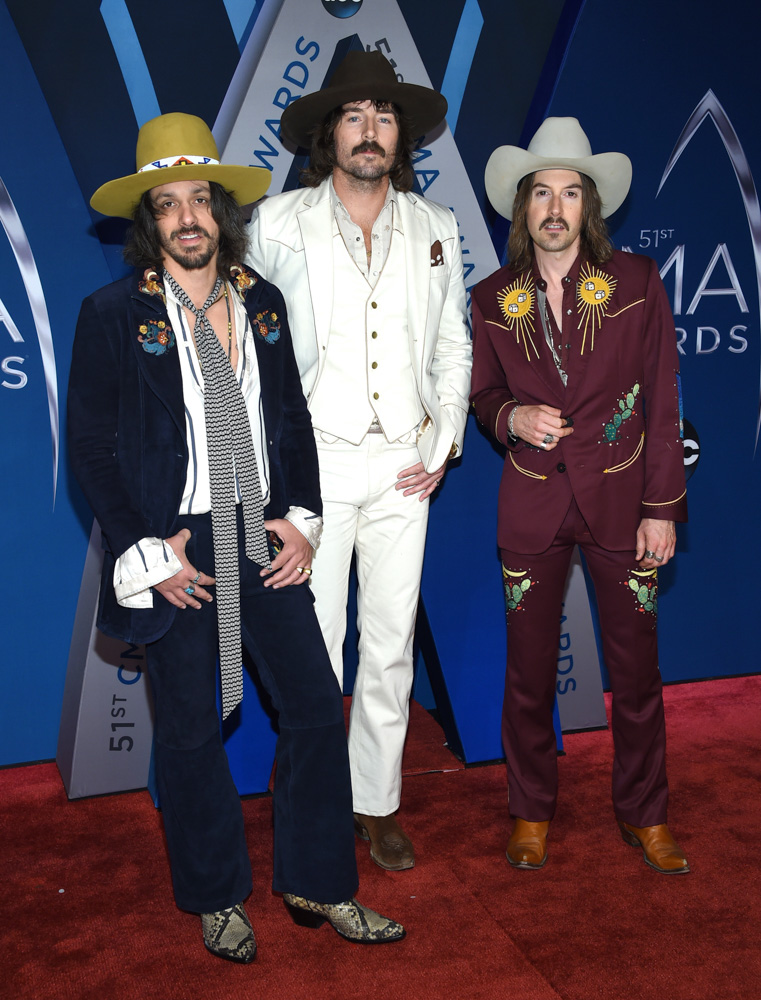 "<div class=""meta image-caption""><div class=""origin-logo origin-image none""><span>none</span></div><span class=""caption-text"">Cameron Duddy, from left, Mark Wystrach and Jess Carson, of Midland, arrive at the 51st annual CMA Awards on Wednesday, Nov. 8, 2017, in Nashville, Tenn. (Evan Agostini/Invision/AP)</span></div>"