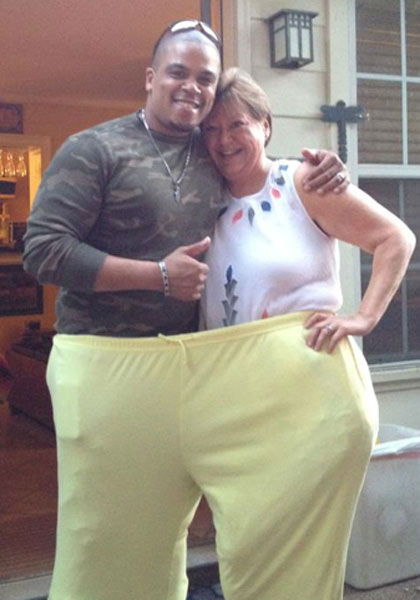 "<div class=""meta image-caption""><div class=""origin-logo origin-image ""><span></span></div><span class=""caption-text"">An ''after'' photo of Riser with her trainer, Shaun Lloyd, in her ''before'' pants</span></div>"