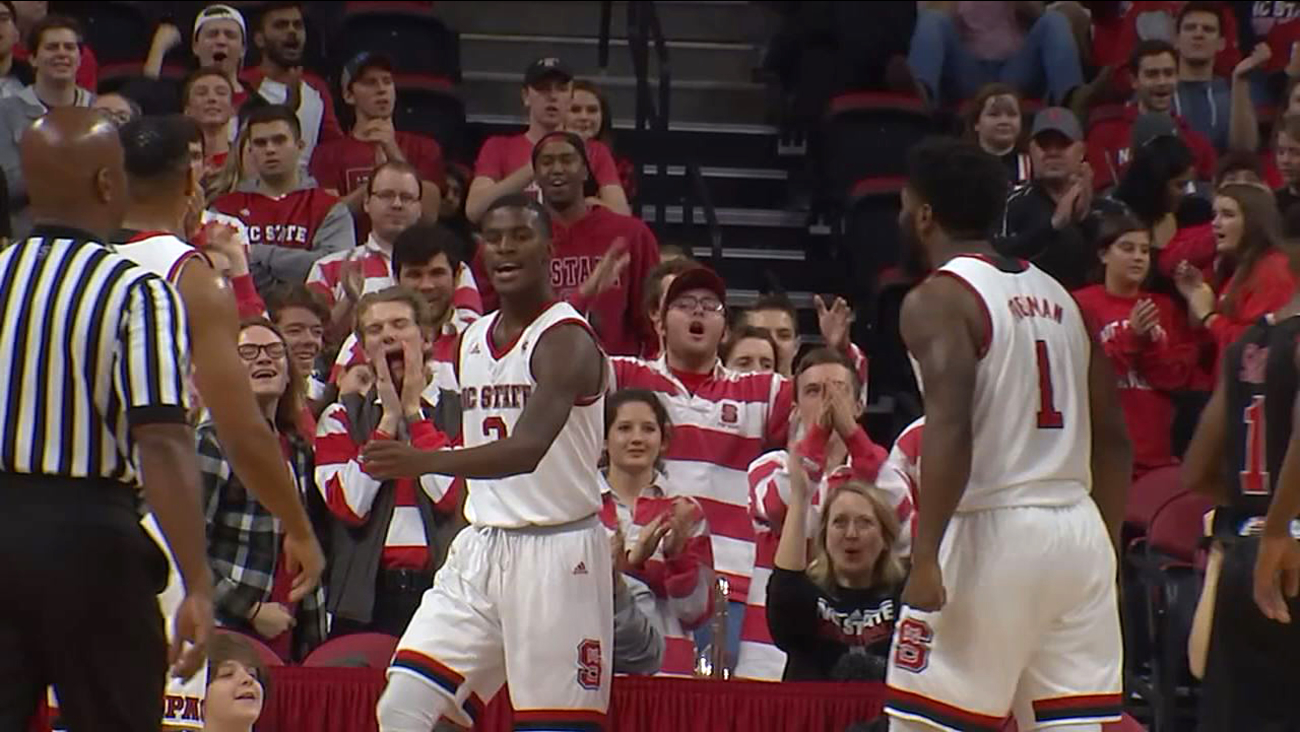 NC State's Lavar Batts is fired up after a driving score as Lennard Freeman looks on Friday.