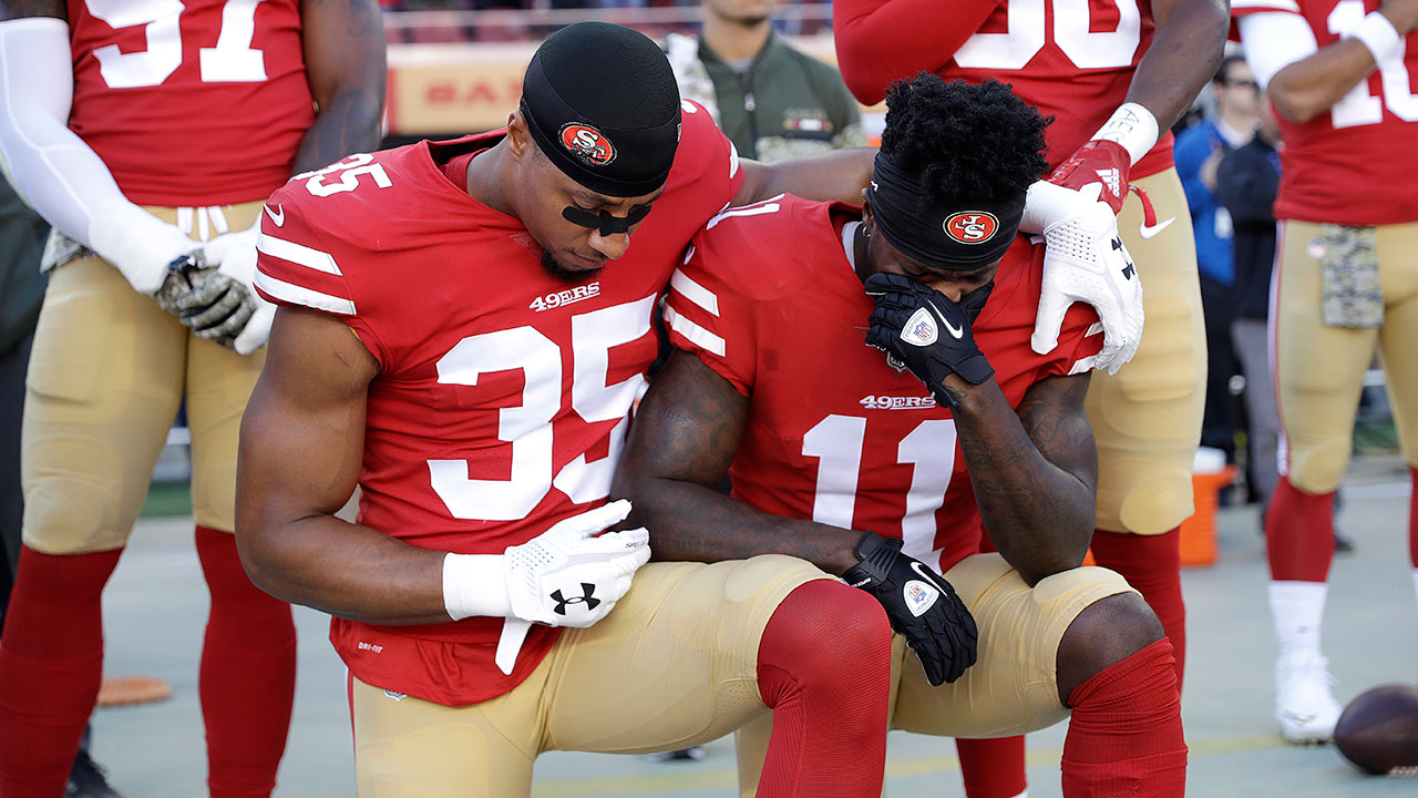 San Francisco 49ers safety Eric Reid (35) and receiver Marquise Goodwin (11) kneel during the performance of the national anthem in Santa Clara, Calif., Sunday, Nov. 12, 2017.