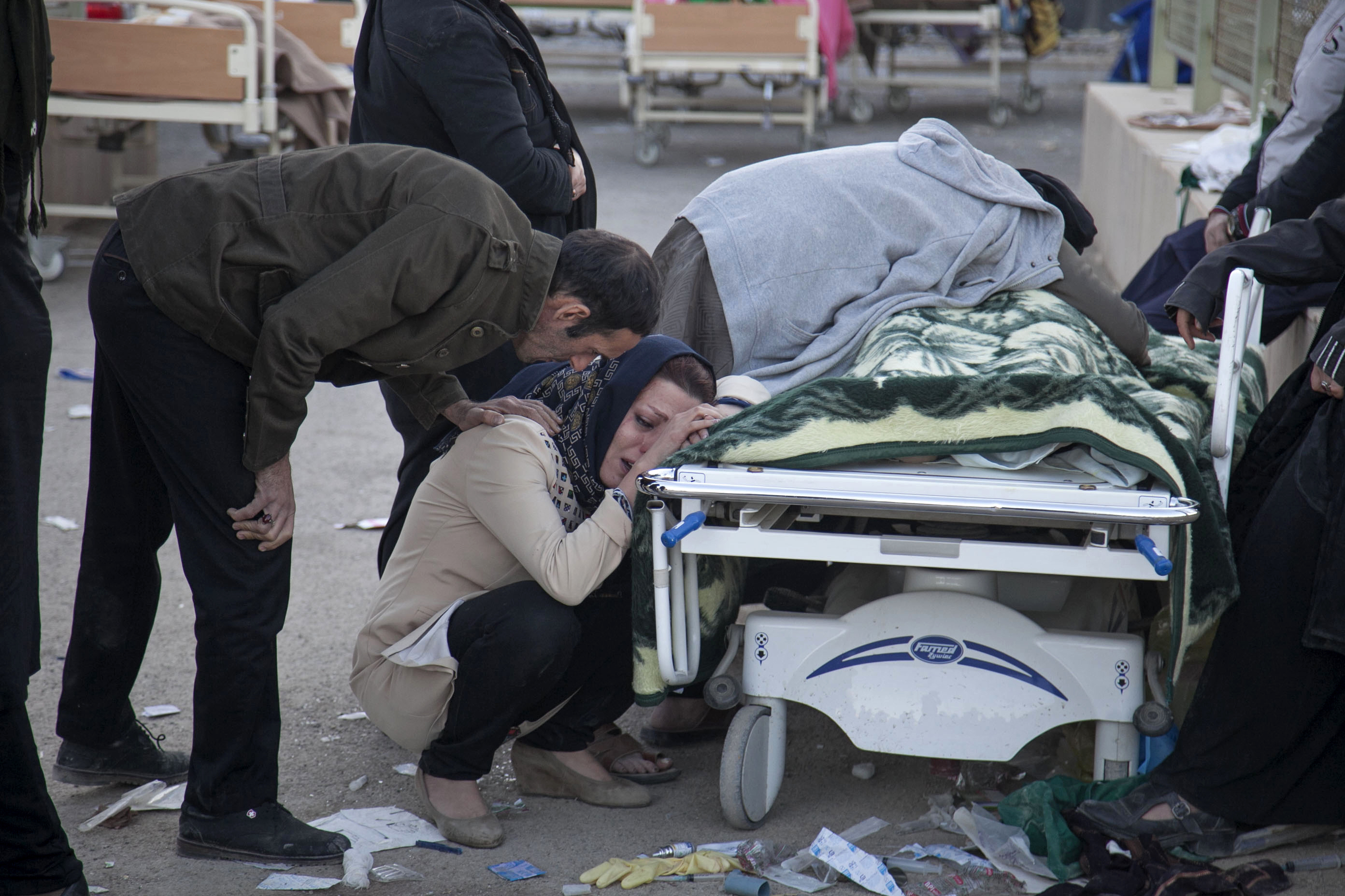 <div class='meta'><div class='origin-logo' data-origin='none'></div><span class='caption-text' data-credit='Farzad Menati/Tasnim News Agency via AP'>In this photo provided by Tasnim News Agency, relatives weep over the body of an earthquake victim,  in Sarpol-e-Zahab, western Iran, Monday, Nov. 13, 2017.</span></div>