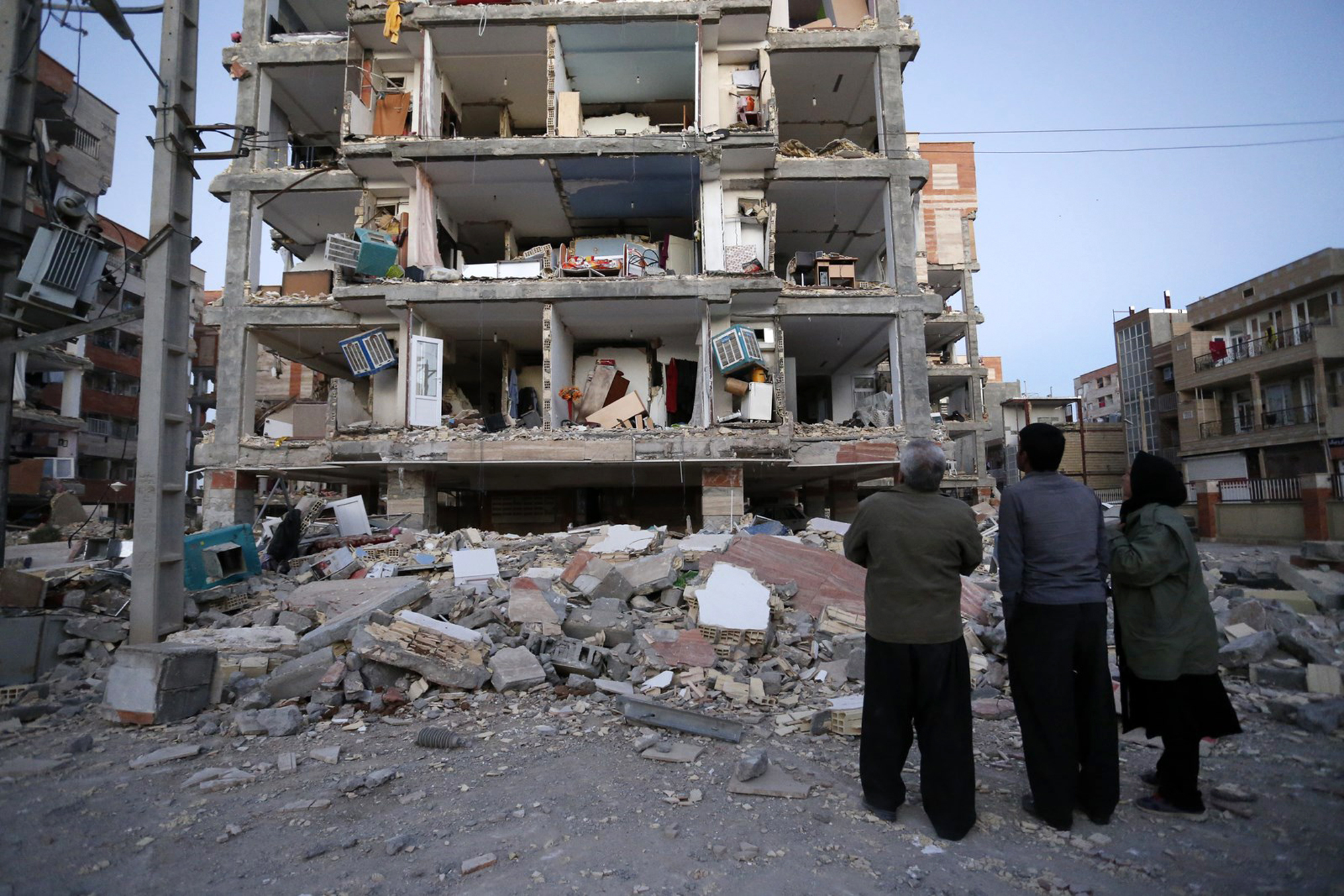 <div class='meta'><div class='origin-logo' data-origin='none'></div><span class='caption-text' data-credit='Pouria Pakizeh/ISNA via AP'>In this photo provided by the ISNA, people look at destroyed buildings after an earthquake at the city of Sarpol-e-Zahab in western Iran, Monday, Nov. 13, 2017.</span></div>