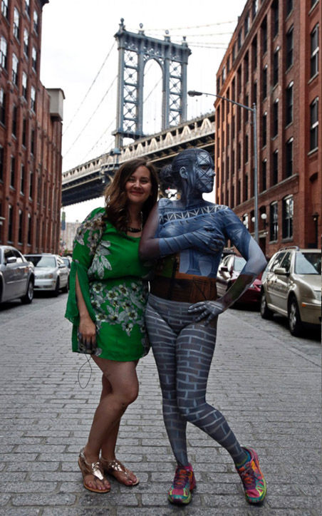 "<div class=""meta image-caption""><div class=""origin-logo origin-image ""><span></span></div><span class=""caption-text"">Merry standing with her subject Jessica Mellow in Dumbo, Brooklyn. (Rachelle Bidner / AP)</span></div>"