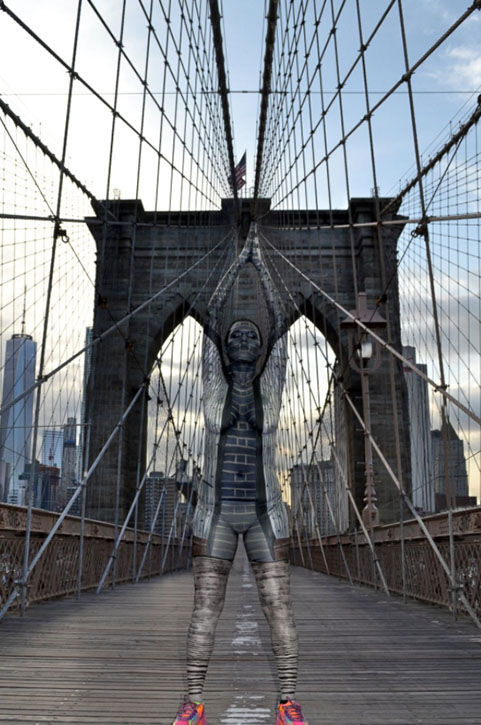 "<div class=""meta image-caption""><div class=""origin-logo origin-image ""><span></span></div><span class=""caption-text"">One of Merry's models posing with the Brooklyn Bridge. (Bodypaintings by Trina Merry)</span></div>"