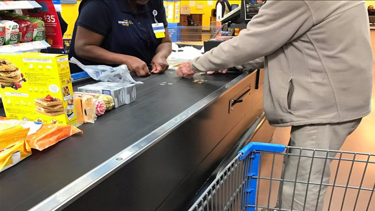 Walmart cashier helps man struggling to count change