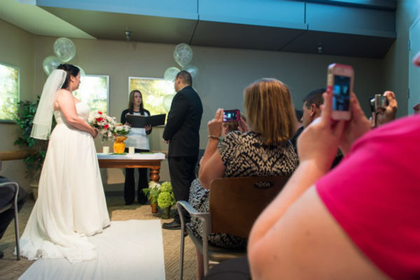 """<div class=""""meta image-caption""""><div class=""""origin-logo origin-image """"><span></span></div><span class=""""caption-text"""">37-year-old James Lauricella and 41-year-old Kimberly Mikucki of Holtsville said their wedding vows Saturday in Chapel at Stony Brook University Hospital. (WABC Photo)</span></div>"""