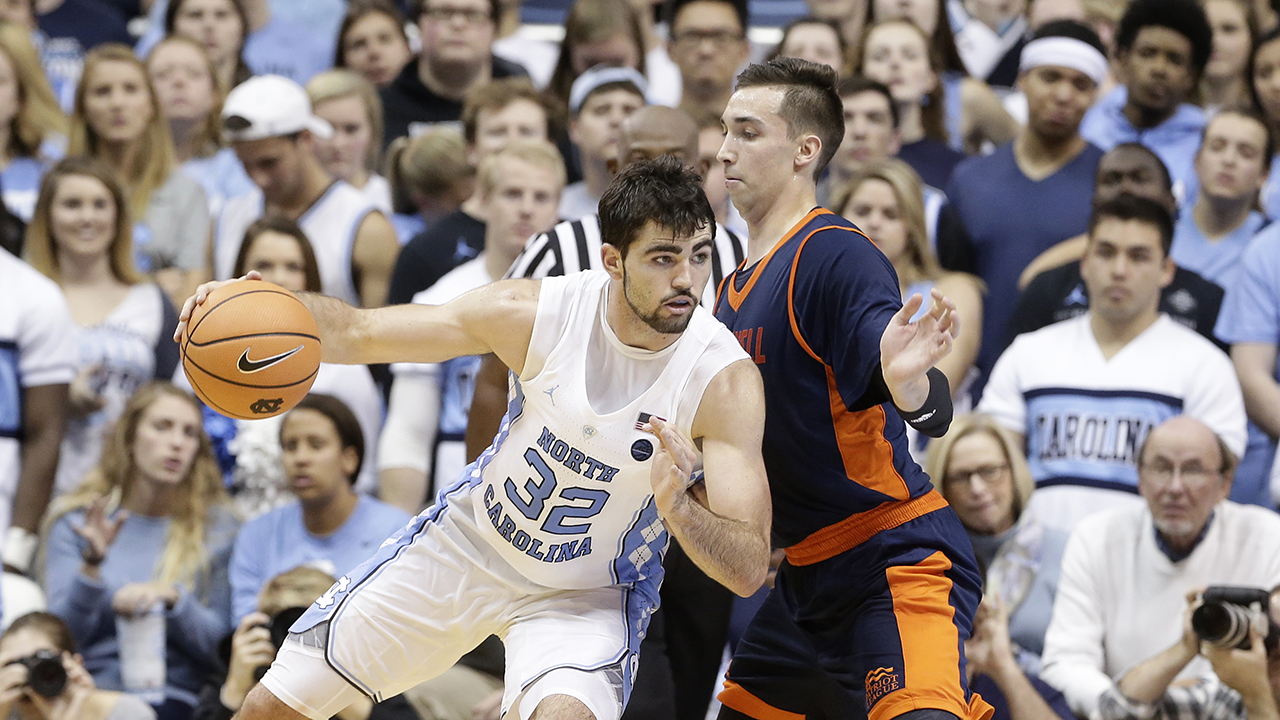 North Carolina's Luke Maye drives on Bucknell's Zach Thomas on Wednesday night in Chapel Hill.