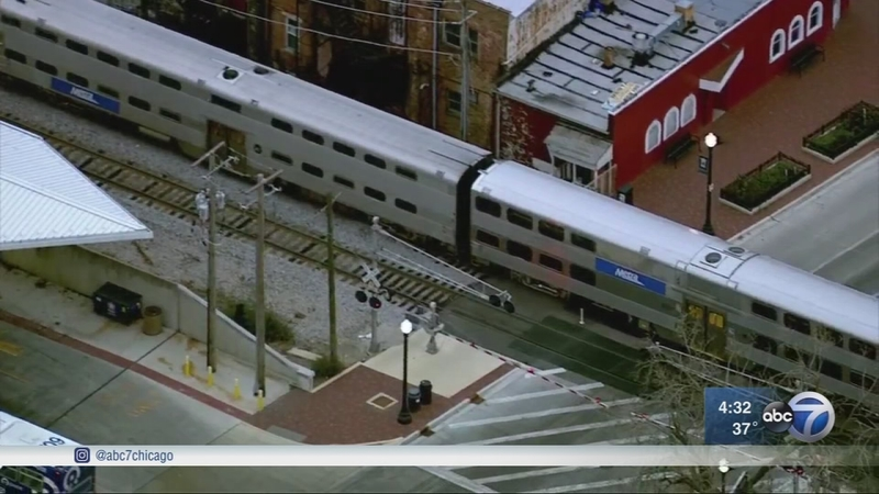 Woman trying to cross tracks fatally struck by Metra train in Elgin, fire  officials say