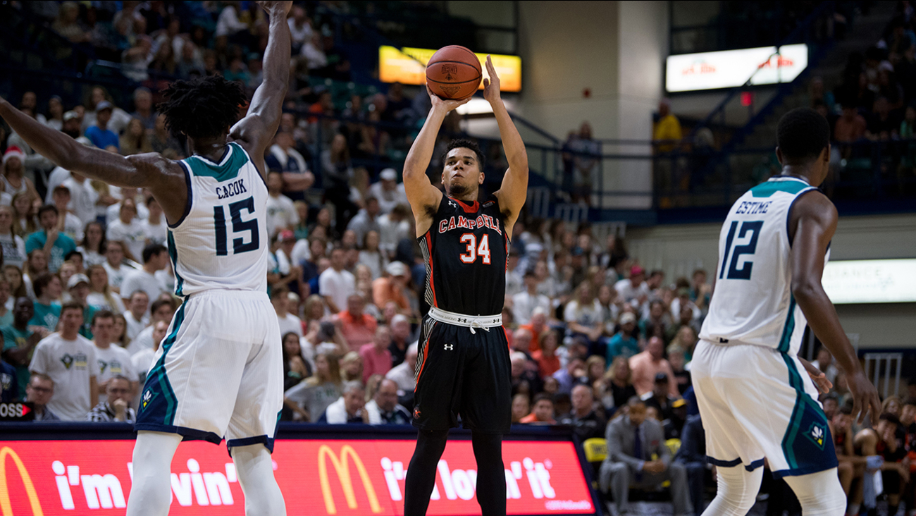 Campbell's Marcus Burk shoots for two of his 33 points against UNC-Wilmington on Saturday.