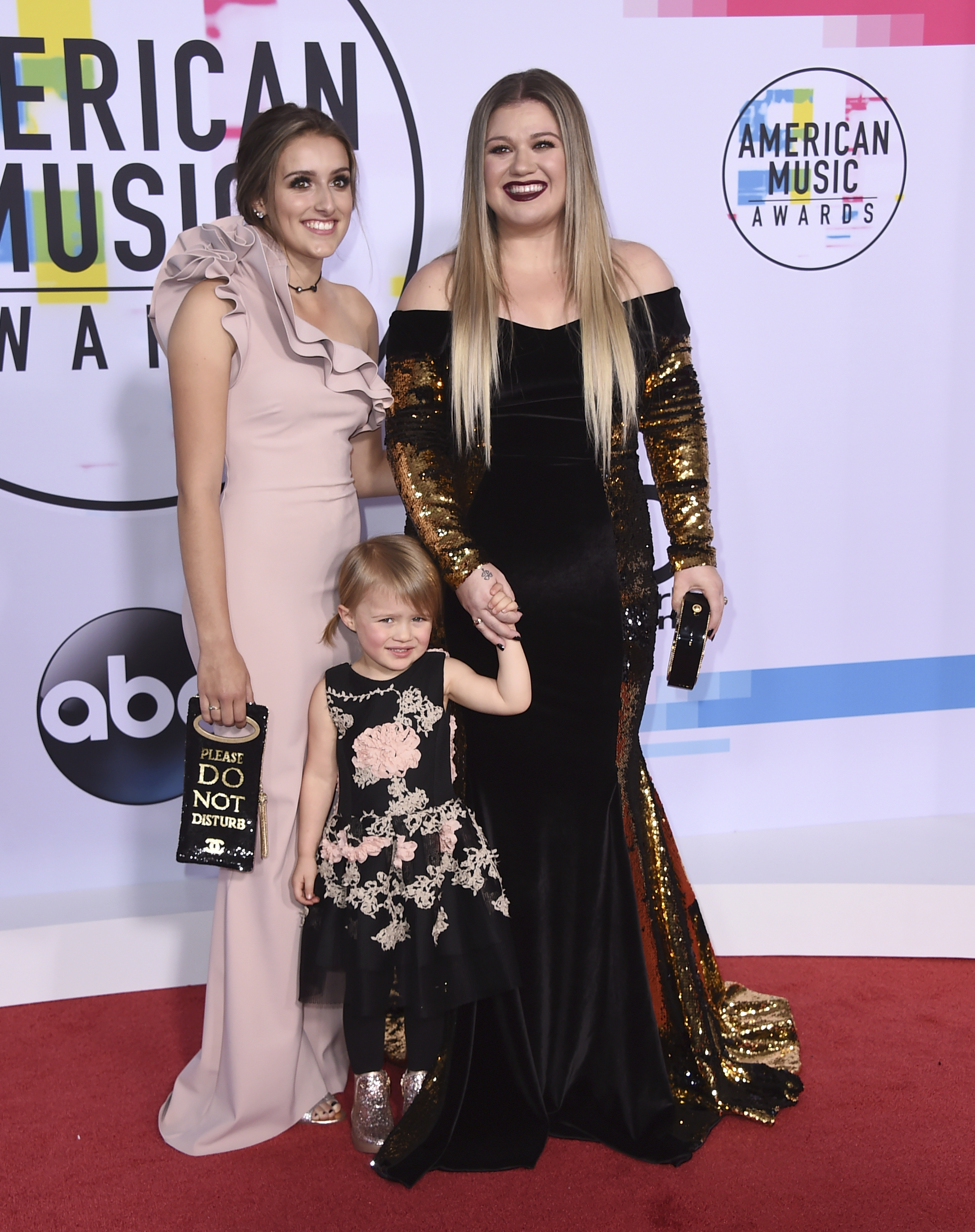 <div class='meta'><div class='origin-logo' data-origin='none'></div><span class='caption-text' data-credit='Jordan Strauss/Invision/AP'>Kelly Clarkson, from right, Savannah Blackstock, and River Rose Blackstock arrive at the American Music Awards at the Microsoft Theater on Sunday, Nov. 19, 2017, in Los Angeles.</span></div>