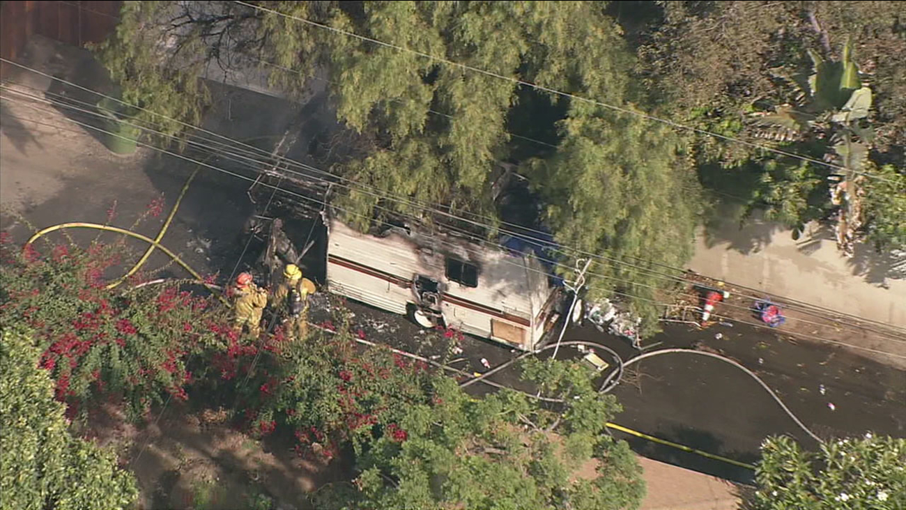 An RV is seen damaged after firefighters extinguished the blaze in the Cheviot Hills area on Monday, Nov. 20, 2017.