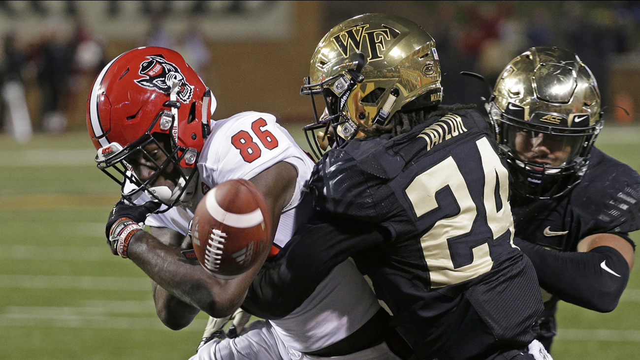 North Carolina State's Emeka Emezie fumbles as he tries to cross the goal line against Wake Forest on Saturday.