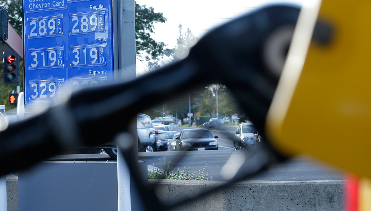 In this photo taken Monday, Oct. 30, 2017, gasoline prices are displayed at a Chevron station in Sacramento, Calif.