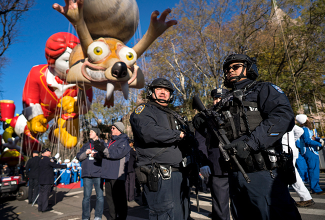 <div class='meta'><div class='origin-logo' data-origin='AP'></div><span class='caption-text' data-credit=''>Heavily-armed members of the New York Police Department take a position along the route before the start of the Macy's Thanksgiving Day Parade Nov. 23,. (AP Photo/Craig Ruttle)</span></div>
