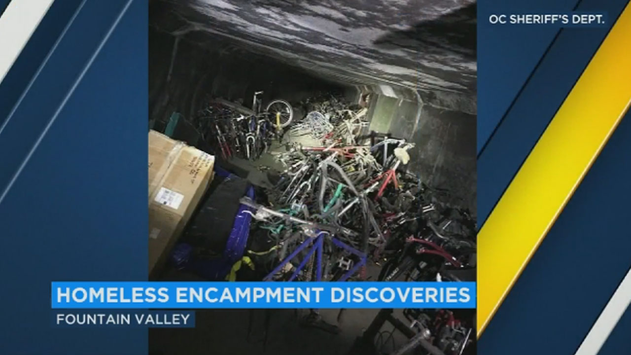 Public Works employees dragged out a pile of bicycles hidden inside a tunnel on the Santa Ana River trail. Nearly 1,000 were found in the homeless encampment.