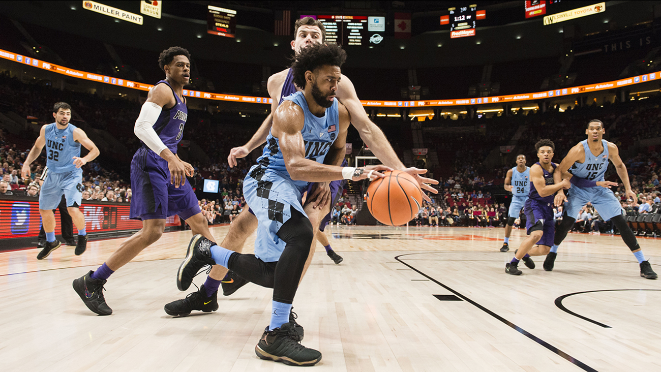 North Carolina guard Joel Berry II, drives past Portland forward Austin Stone on Thursday at PK80 tournament in Portland, Ore.