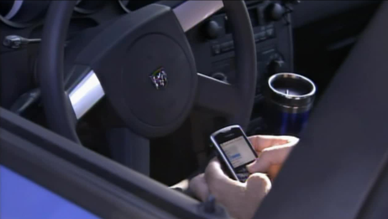 A person texts while inside a car in this undated file photo.