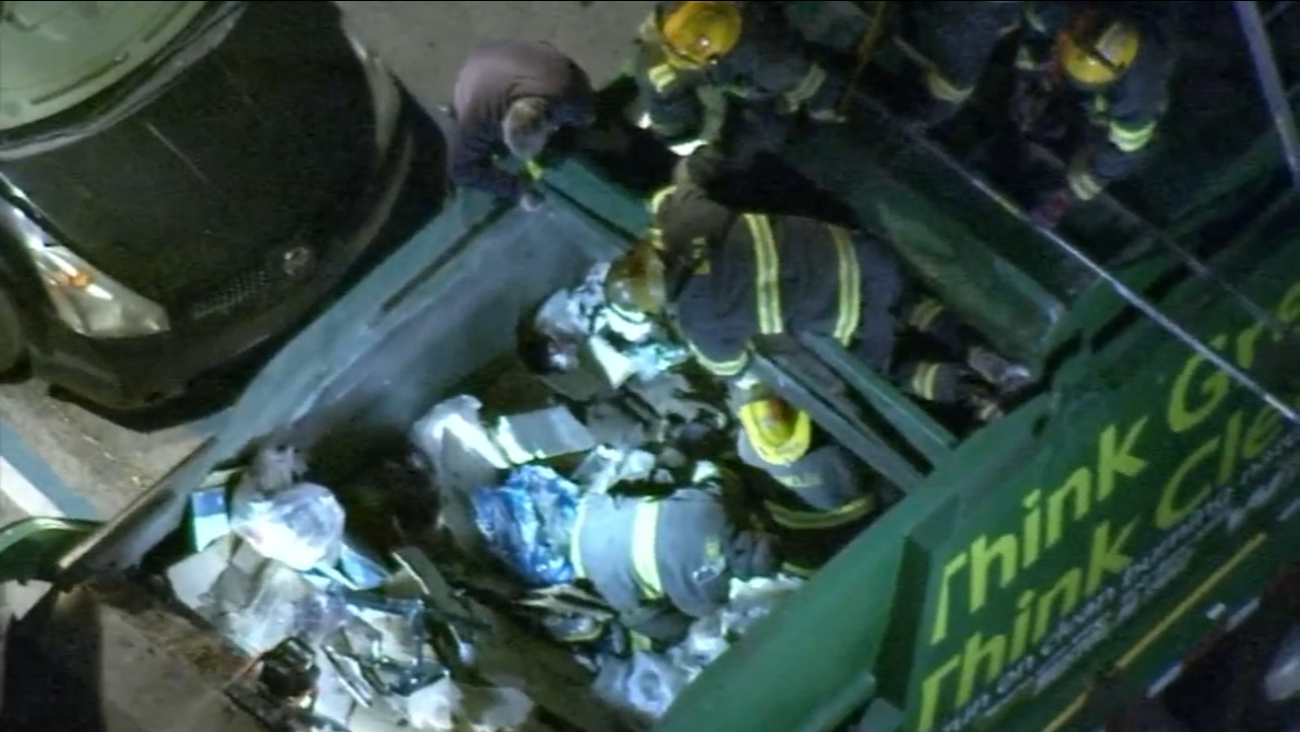 Man rescued from trash truck in Juniata