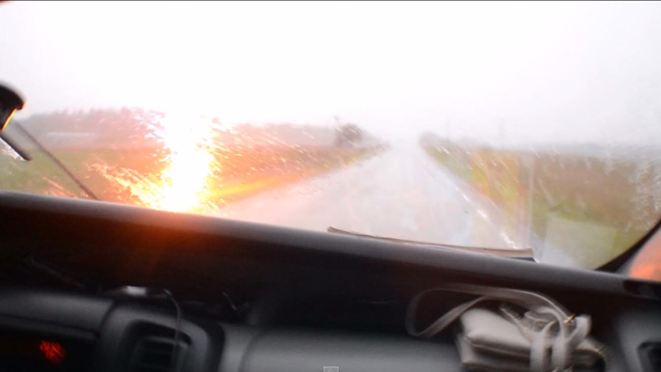 Lightning strikes hear car