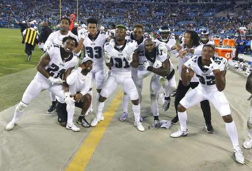 <div class='meta'><div class='origin-logo' data-origin='AP'></div><span class='caption-text' data-credit='AP Photo/Bob Leverone'>Philadelphia Eagles players celebrates in the final seconds of the second half of an NFL football game in Charlotte, N.C., Thursday, Oct. 12, 2017.</span></div>