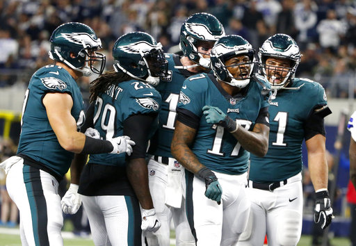 <div class='meta'><div class='origin-logo' data-origin='AP'></div><span class='caption-text' data-credit='AP Photo/Michael Ainsworth'>Philadelphia Eagles' Brent Celek, from left, LeGarrette Blount (29), Carson Wentz, rear, and Stefen Wisniewski, right, celebrate a touchdown catch made by Alshon Jeffery (17).</span></div>