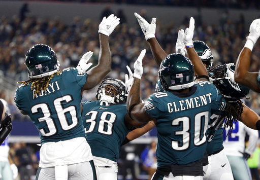 <div class='meta'><div class='origin-logo' data-origin='AP'></div><span class='caption-text' data-credit='AP Photo/Michael Ainsworth'>Philadelphia Eagles' Jay Ajayi (36), Kenjon Barner (38) and Corey Clement (30) along with others celebrate a touchdown by Barner in the first half of a football game against Dallas</span></div>