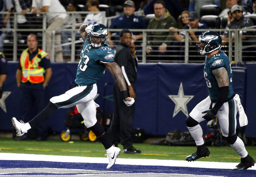 <div class='meta'><div class='origin-logo' data-origin='AP'></div><span class='caption-text' data-credit='AP Photo/Michael Ainsworth'>Philadelphia Eagles linebacker Nigel Bradham (53) and Chris Long (56) celebrate a touchdown scored by Bradham after Bradham recovered a Dallas Cowboys' Dak Prescott fumble.</span></div>