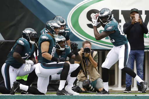 <div class='meta'><div class='origin-logo' data-origin='AP'></div><span class='caption-text' data-credit='AP Photo/Matt Rourke'>Philadelphia Eagles' Torrey Smith, right, celebrates with teammates after scoring a touchdown during the first half of an NFL football game against the Arizona Cardinals.</span></div>