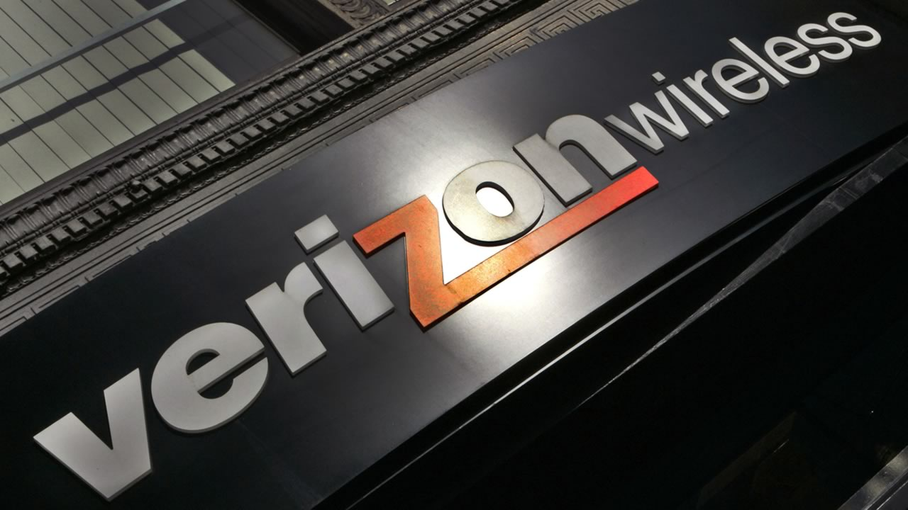 In this Oct. 30, 2006, file photo, a Verizon Wireless store sign is seen in a Portland, Ore. (AP Photo/Don Ryan, File)