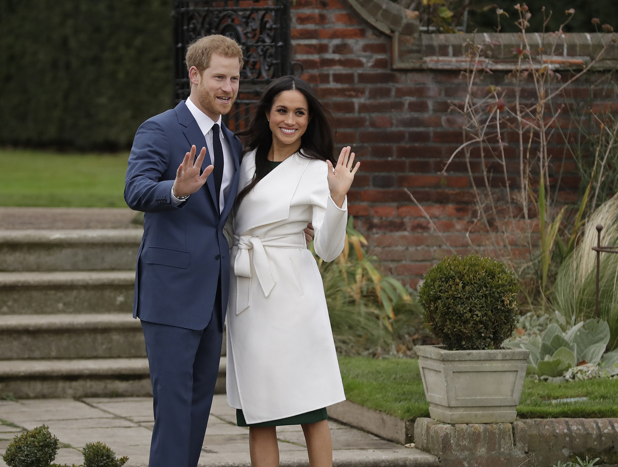 <div class='meta'><div class='origin-logo' data-origin='AP'></div><span class='caption-text' data-credit='AP Photo/Matt Dunham'>Britain's Prince Harry and his fiancee Meghan Markle pose for photographers during a photocall in the grounds of Kensington Palace in London, Monday Nov. 27, 2017.</span></div>